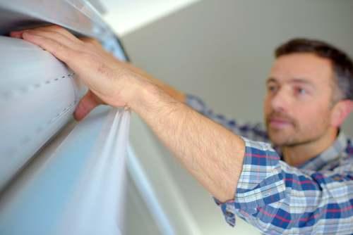 Arreglar persiana metálica enrollable de comercio,bajos  y garajes